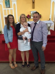 Rhys Thomas Patrick Clancy with his parents Cecilia and Christy and his sister Alanna on his baptism day.